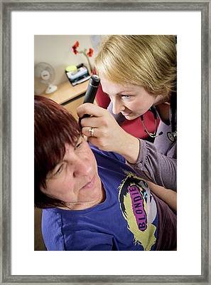 Gp Examining Patient Framed Print