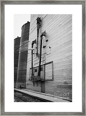grain elevator doors and filling pipe leader Saskatchewan Canada Framed Print