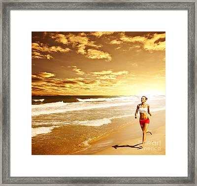 Healthy Woman Running On The Beach Framed Print by Anna Om