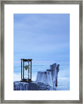 Hourglass Blue Sky Framed Print