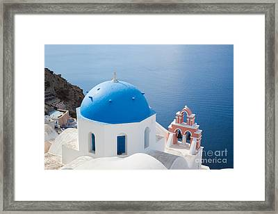 Iconic Blue Domed Churches In Oia Santorini Greece Framed Print by Matteo Colombo