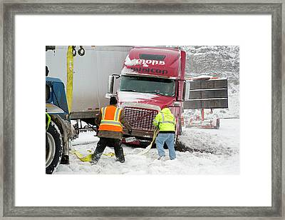 Jackknifed Truck Blocking Highway Framed Print by Jim West