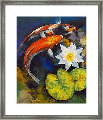 Koi Fish And Water Lily Framed Print by Michael Creese