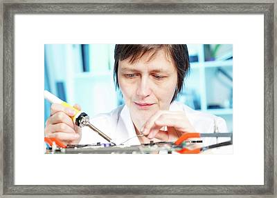 Lab Assistant Working On Circuit Board Framed Print