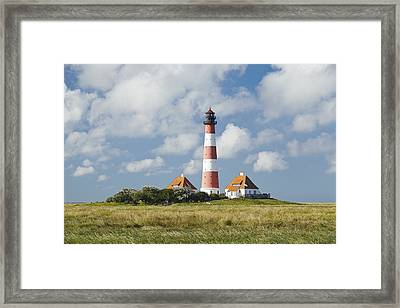 Lighthouse Westerhever And Foreshore Framed Print by Olaf Schulz