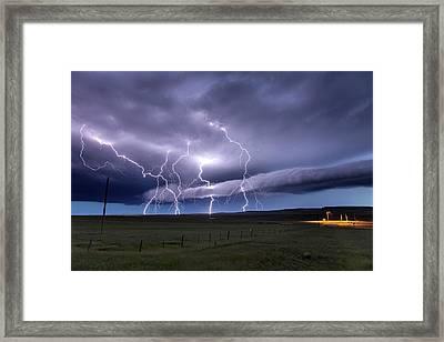 Lightning Strikes Framed Print by Roger Hill