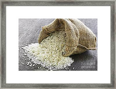 Long Grain Rice In Burlap Sack Framed Print by Elena Elisseeva
