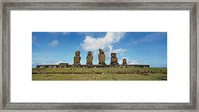 Low Angle View Of Moai Statues Framed Print