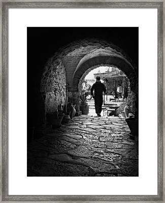 Framed Print featuring the photograph Man In An Archway / Hammamet by Barry O Carroll