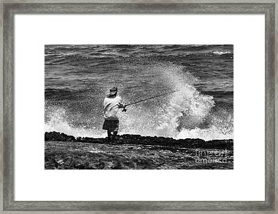 Man Versus The Sea Framed Print by Mike  Dawson