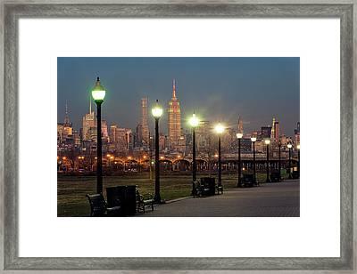 Manhattan Skyline At Twilight, Liberty Framed Print by F. M. Kearney