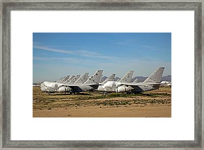 Military Aircraft In Salvage Yard Framed Print by Jim West