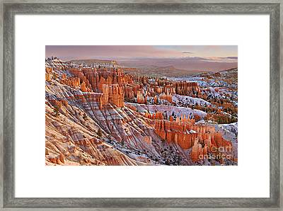 Framed Print featuring the photograph Morning Snow At Bryce by Roman Kurywczak