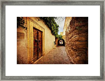 Framed Print featuring the photograph Narrow Street In Souk / Hammamet by Barry O Carroll