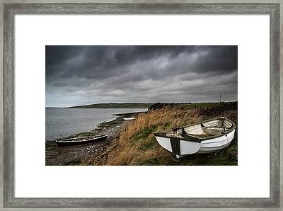 Old Decayed Rowing Boats On Shore Of Lake With Stormy Sky Overhe Framed Print by Matthew Gibson