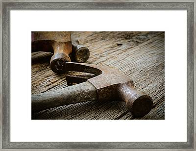 Old Hammers On Rustic Wood Background Framed Print