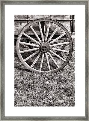 Old Wagon Wheel On Cart Framed Print