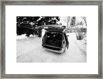 packing musicians equipment into mpv vehicle in Regina Saskatchewan Canada Framed Print by Joe Fox