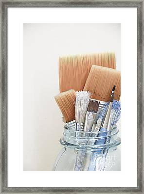Paint Brushes In Jar Framed Print by Birgit Tyrrell