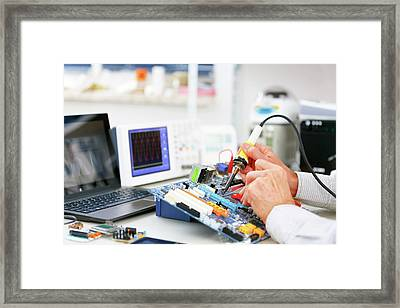 Person Repairing Electronic Circuit Board Framed Print by Wladimir Bulgar