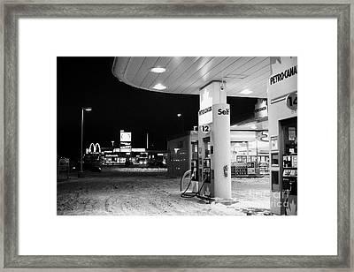 petro canada winter gas fuel pump at service station Regina Saskatchewan Canada Framed Print by Joe Fox