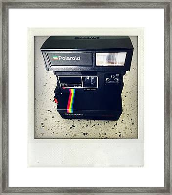 Polaroid Camera.  Framed Print by Les Cunliffe