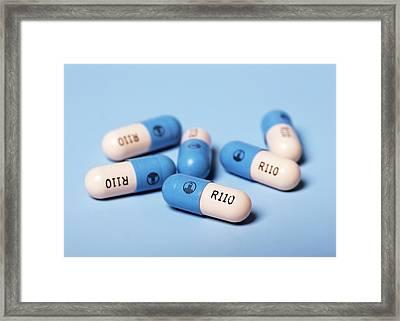 Pradaxa Drug Capsules Framed Print by Mark Thomas