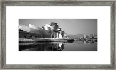 Reflection Of A Museum On Water Framed Print by Panoramic Images