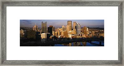 Reflection Of Buildings In A River Framed Print