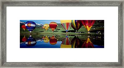 Reflection Of Hot Air Balloons Framed Print by Panoramic Images
