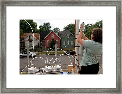 Researcher Recording Air Pollution Levels Framed Print by Jim West