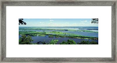 River Flowing Through A Landscape Framed Print by Panoramic Images