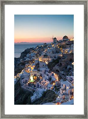 Romantic Sunset Over The Village Of Oia Greece Santorini Framed Print