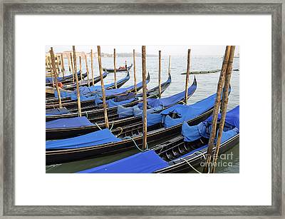 Row Of Empty Moored Gondolas Framed Print