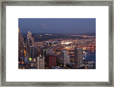 Seattle Skyline With Mount Rainier And Downtown City Lights Framed Print