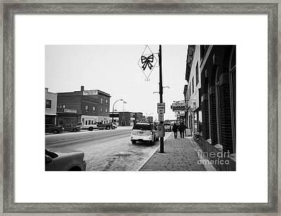 shops and stores on the main street Biggar Saskatchewan Canada in winter Framed Print by Joe Fox