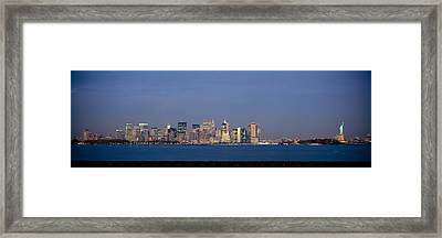 Skyscrapers And A Statue Framed Print by Panoramic Images