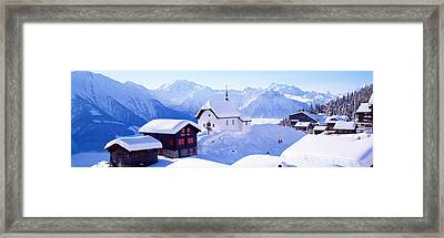 Snow Covered Chapel And Chalets Swiss Framed Print
