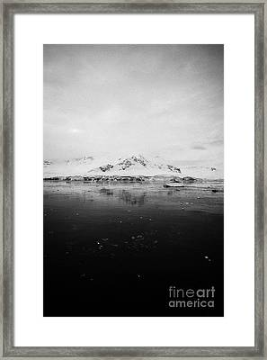 snow covered landscape in Fournier Bay on Anvers Island Antarctica Framed Print by Joe Fox