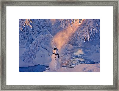 Snowman Standing Next To A Stream Framed Print