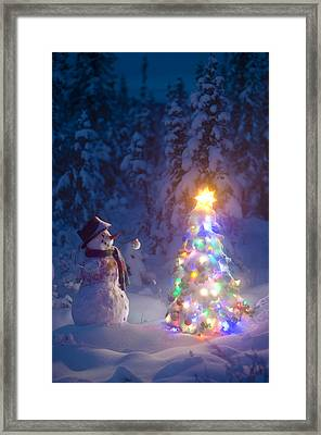 Snowman Stands In A Snowcovered Spruce Framed Print by Kevin Smith