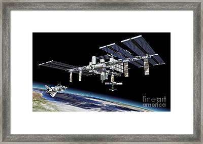 Space Station In Orbit Around Earth Framed Print by Leonello Calvetti