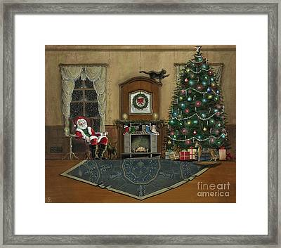 St. Nicholas Sitting In A Chair On Christmas Eve Framed Print by John Lyes