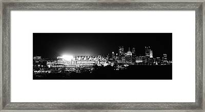Stadium Lit Up At Night In A City Framed Print