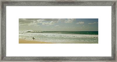 Surfer Standing On The Beach, North Framed Print