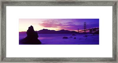 Suspension Bridge Across A Bay At Dusk Framed Print