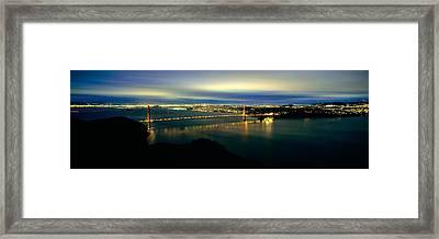 Suspension Bridge Lit Up At Dusk Framed Print