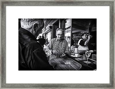 The Daily Game Framed Print by John Hesley