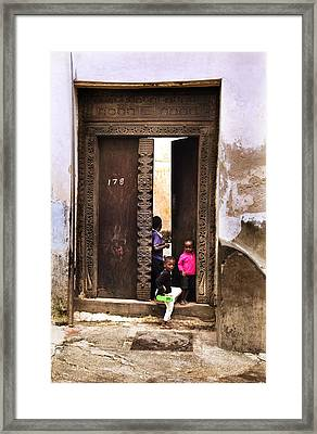 Framed Print featuring the photograph Kids Playing Zanzibar Unguja Doorway by Amyn Nasser