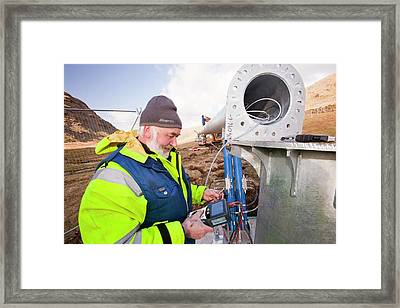 Three Wind Turbines Being Constructed Framed Print by Ashley Cooper